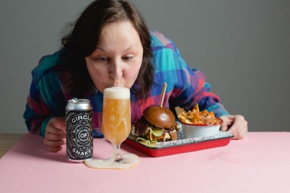 Jules pictured with a Hop Hideout beer and some food from Kommune's Fat Hippo. [Permission granted by Jules Gray to share image]