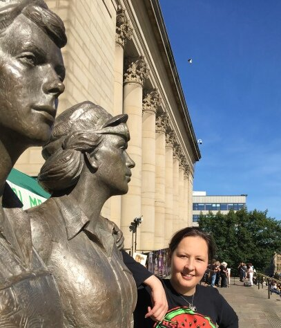 Jules pictured next to the Women of Steel statue in the city centre, near the City Hall. [Permission granted by Jules Gray to share image]